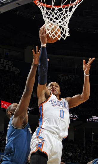 Oklahoma City's Russell Westbrook (0) takes a shot during the NBA basketball game between the Washington Wizards and the Oklahoma City Thunder at the Oklahoma City Arena in Oklahoma City, Friday, January 28, 2011. Photo by Nate Billings, The Oklahoman