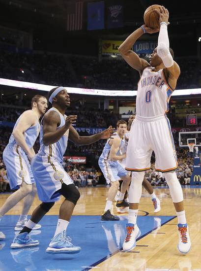 Oklahoma City's Russell Westbrook (0) shoots over Denver's Ty Lawson (3) during the NBA basketball game between the Oklahoma City Thunder and the Denver Nuggets at the Chesapeake Energy Arena on Wednesday, Jan. 16, 2013, in Oklahoma City, Okla.  Photo by Chris Landsberger, The Oklahoman
