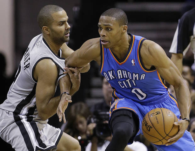 Oklahoma Thunder's Russell Westbrook (0) is pressured by San Antonio Spurs' Tony Parker, left, of France, during the second quarter of an NBA basketball game, Thursday, Nov. 1, 2012, in San Antonio. (AP Photo/Eric Gay) ORG XMIT: TXEG110
