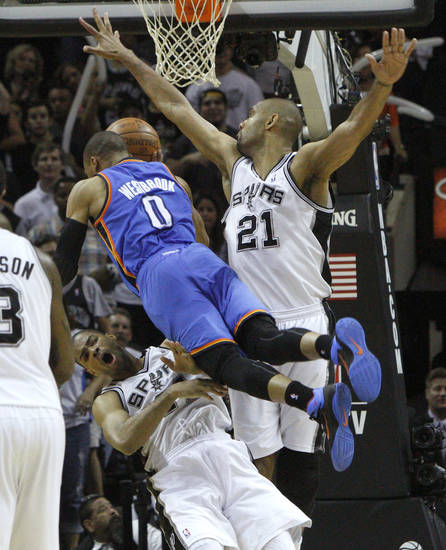Oklahoma City's Russell Westbrook (0) runs into San Antonio's Gary Neal (14) and Tim Duncan (21) during Game 1 of the Western Conference Finals between the Oklahoma City Thunder and the San Antonio Spurs in the NBA playoffs at the AT&T Center in San Antonio, Texas, Sunday, May 27, 2012. Oklahoma City lost 101-98. Photo by Bryan Terry, The Oklahoman