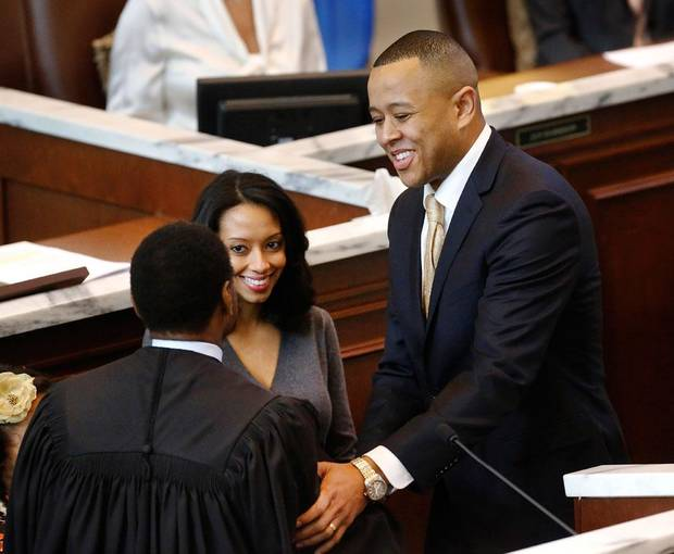 T. W. Shannon thanks Chief Justice Tom Colbert after he was  sworn in as Speaker of the House. At his side is his wife, Devon.  Shannon was elected by his colleagues in the Oklahoma House of Representatives as their Speaker for the upcoming legislative session. Shannon, a Republican  from Lawton, is Oklahoma's first black Speaker of the House. He was sworn in on the floor of the House by Oklahoma Supreme Court Chief Justice Tom Colbert on Tuesday, Jan. 8, 2013.  Colbert became  Oklahoma's first black chief justice when he was sworn in last week.    Photo by Jim Beckel, The Oklahoman