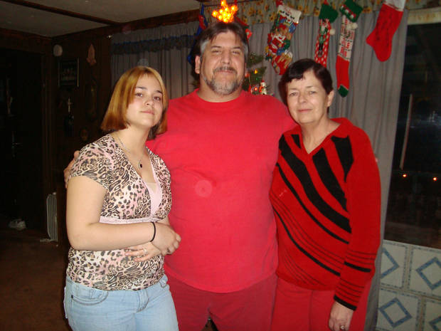 Kaylee Famrough, 13, lost both parents - Susan Gail Fambrough, 54; and William Vincent Fambrough, 48 - to a tornado Tuesday night and barely escaped with her own life. This is the three of them celebrating Christmas last year. Photo provided.