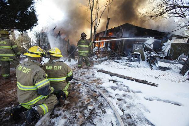 SNOW / BLIZZARD / WINTER STORM / COLD WEATHER / AFTERMATH: Firefighters battle a house fire in the 1900 block of E Harrison in Guthrie County, February  3 , 2011. Photo by Steve Gooch, The Oklahoman ORG XMIT: KOD