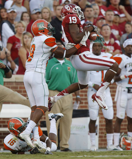 Oklahoma&#039;s Justin Brown (19) catches pass in front of Florida A&amp;M&#039;s Jonathan Pillow (19), and  Antwain Mathews (16) during the college football game between the University of Oklahoma Sooners (OU) and Florida A&amp;M Rattlers at Gaylord Family-Oklahoma Memorial Stadium in Norman, Okla., Saturday, Sept. 8, 2012. Photo by Bryan Terry, The Oklahoman