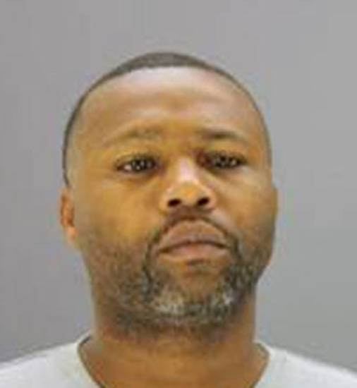 Van Dralan Dixson is shown in this photo provided by the Dallas Police Department. Authorities have located a car belonging to Dixson, a crime watch volunteer charged in one of nine sexual assaults in South Dallas. (AP Photo/Dallas Police Department)