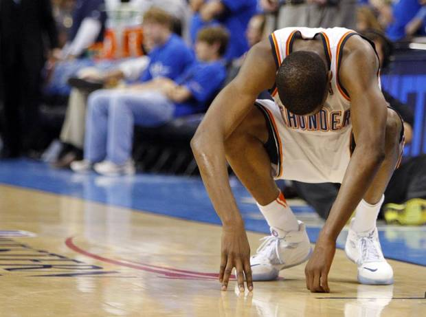 Oklahoma City's Kevin Durant (35) reacts late in overtime during game 4 of the Western Conference Finals in the NBA basketball playoffs between the Dallas Mavericks and the Oklahoma City Thunder at the Oklahoma City Arena in downtown Oklahoma City, Monday, May 23, 2011. Dallas won in overtime, 112-105. Photo by Nate Billings, The Oklahoman ORG XMIT: KOD