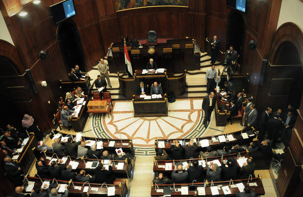The Islamist-dominated panel vote on a final draft of a new Egyptian constitution in Cairo, Egypt, Thursday, Nov. 29, 2012. The assembly, overwhelmingly made up of allies of President Mohammed Morsi, abruptly moved up the vote which hadn't been expected to take place for another two months in order to pass the draft before Egypt's Supreme Constitution Court rules on Sunday on whether to dissolve the panel. (AP Photo/Mohammed Asad)