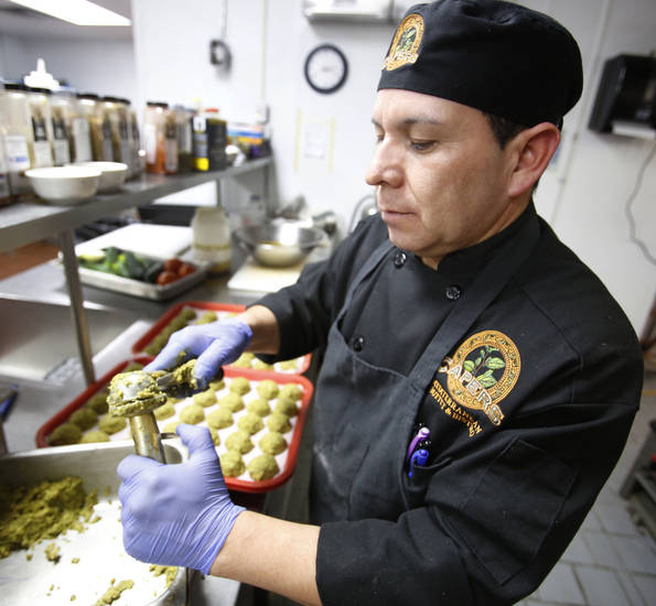 Manuel Gonzales prepares falafel at Capers Mediterranean Buffet and Bistro. <strong>STEVE GOOCH - THE OKLAHOMAN</strong>