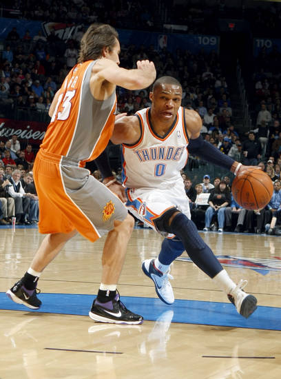 Oklahoma City's Russell Westbrook (0) tries to get past Phoenix's Steve Nash (13) during the NBA game between the Oklahoma City Thunder and the Phoenix Suns, Sunday, March 6, 2011, the Oklahoma City Arena. Photo by Sarah Phipps, The Oklahoman.