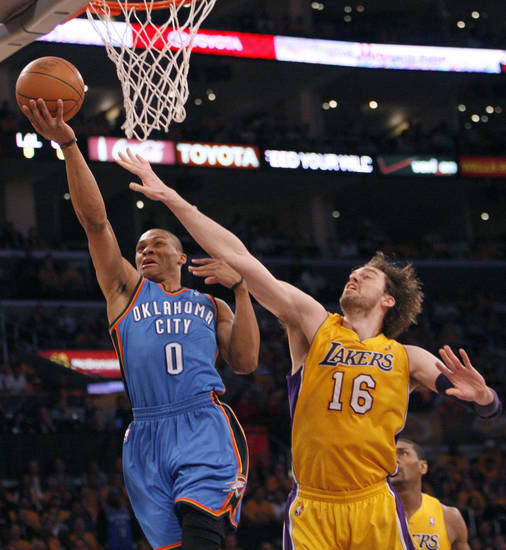 Oklahoma City's Russell Westbrook (0) shoots over Los Angeles' Pau Gasol (16) during Game 3 in the second round of the NBA basketball playoffs between the L.A. Lakers and the Oklahoma City Thunder at the Staples Center in Los Angeles, Friday, May 18, 2012. Photo by Nate Billings, The Oklahoman