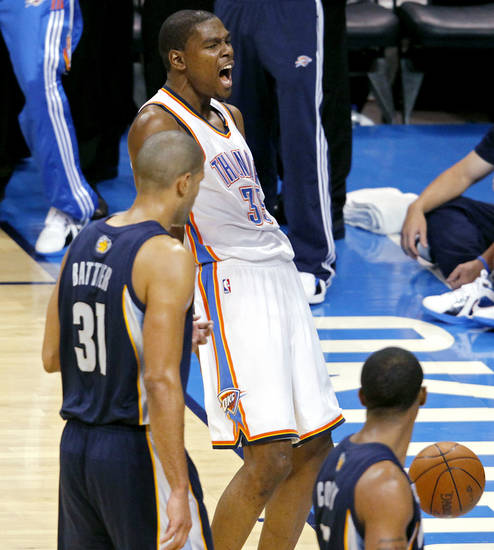 Kevin Durant celebrates in front of Shane Battier and Mike Conley (bottom) after a slam during the second half of game 7 of the NBA basketball Western Conference semifinals between the Memphis Grizzlies and the Oklahoma City Thunder at the OKC Arena in Oklahoma City, Sunday, May 15, 2011. The Thunder beat the Grizzlies 105-90 to advance to the Western Conference finals against Dallas. Photo by John Clanton, The Oklahoman