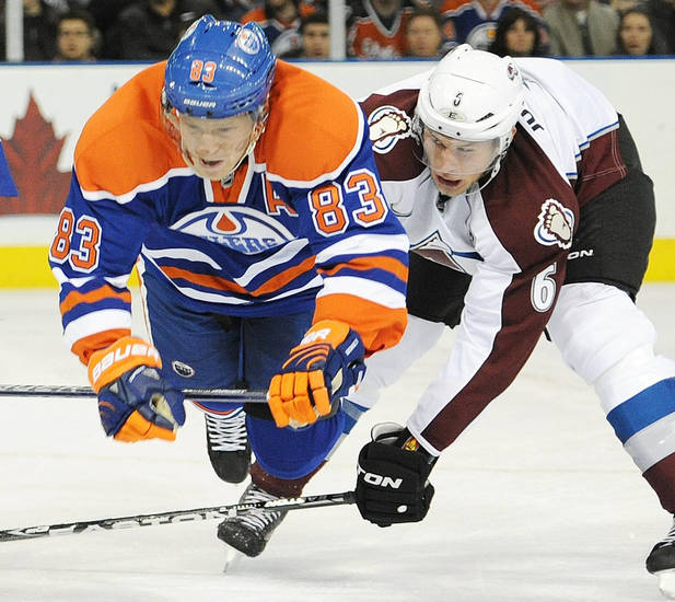 Colorado Avalanche's Bryan Allen, right, trips Edmonton Oilers' Ales Hemsky during the first period of an NHL hockey game in Edmonton, Alberta, on Friday, Dec. 9, 2011. (AP Photo/The Canadian Press, John Ulan)