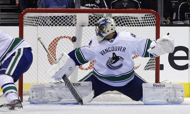 Vancouver Canucks goalie Roberto Luongo blocks a shot against the Los Angeles Kings during the first period of an NHL Hockey game in Los Angeles, Monday, Jan. 28, 2013. (AP Photo/Chris Carlson)