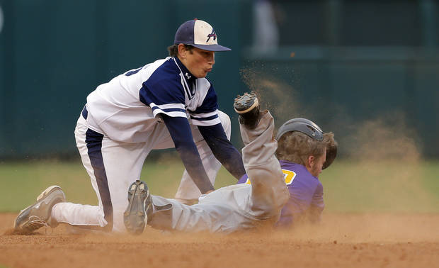 Asher&#039;s Tammen Andrews tag outs Red Oaks Dillon Morris during the Class B Fall baseball state at the Chickasaw Bricktown Ballpark between Red Oak and Asher  in Oklahoma City, Saturday, Oct. 6, 2012. Photo by Sarah Phipps, The Oklahoman
