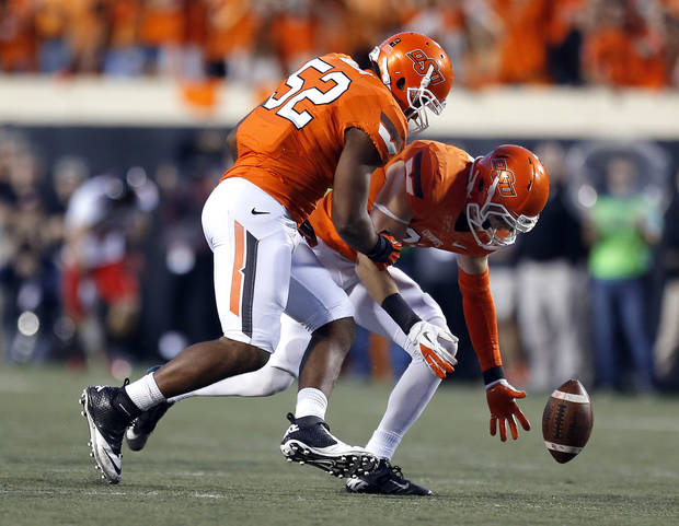 Oklahoma State's Zack Craig (23) and Oklahoma State's Ryan Simmons (52) recover a block punt during a college football game between Oklahoma State University and the Texas Tech University (TTU) at Boone Pickens Stadium in Stillwater, Okla., Saturday, Nov. 17, 2012. Photo by Sarah Phipps, The Oklahoman