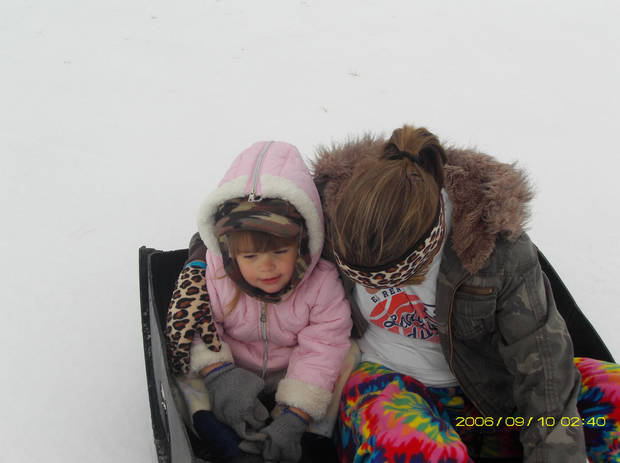 Haley McCurdy and Kelsy Baker are using a tub to sled down the driveway! What a good day.<br/><b>Community Photo By:</b> Michelle Baker<br/><b>Submitted By:</b> michelle, El Reno