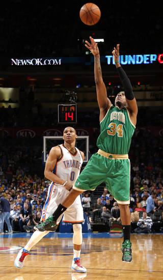 Boston's Paul Pierce (34) shoots in front of Oklahoma City's Russell Westbrook (0) during the NBA game between the Oklahoma City Thunder and the Boston Celtics at the Chesapeake Energy Arena in Oklahoma City, Sunday, March 10, 2013. Photo by Sarah Phipps, The Oklahoman