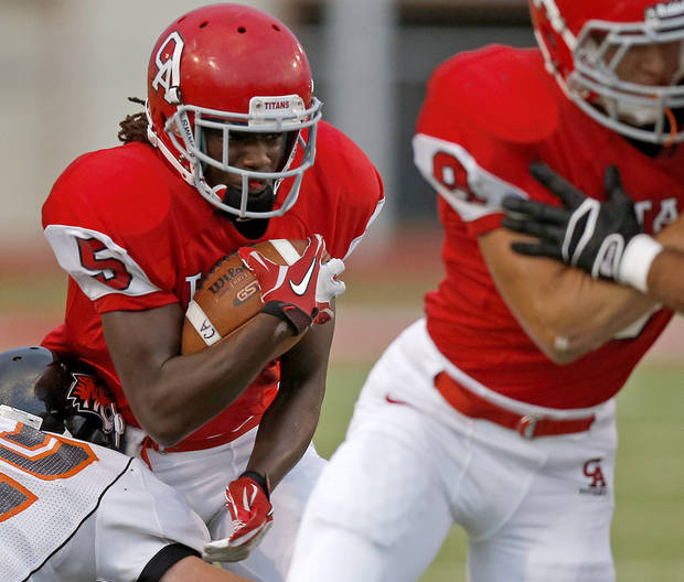 Carl Albert's Bryan Williams runs against Coweta during a high school football game at Carl Albert in Midwest City, Friday, September 7, 2012. Photo by Bryan Terry, The Oklahoman