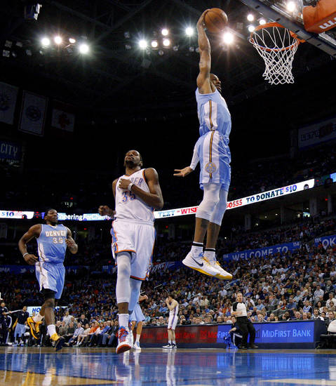 Andre Iguodala (9) dunks the ball in front of Oklahoma City's Kevin Durant (35) during an NBA basketball game between the Oklahoma City Thunder and the Denver Nuggets at Chesapeake Energy Arena in Oklahoma City, Tuesday, March 19, 2013. Denver won 114-104. Photo by Bryan Terry, The Oklahoman
