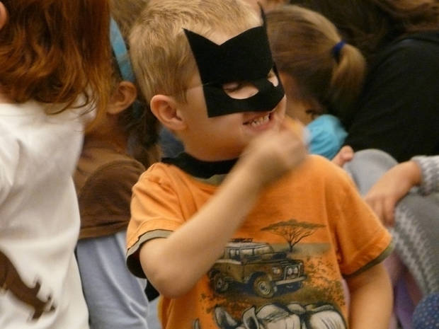 Right: Aaron Crook, 4, wearing a Batman mask, reacts to performers with the Cimarron Opera Company. PHOTO BY CONNIE HEFNER, FOR THE OKLAHOMAN