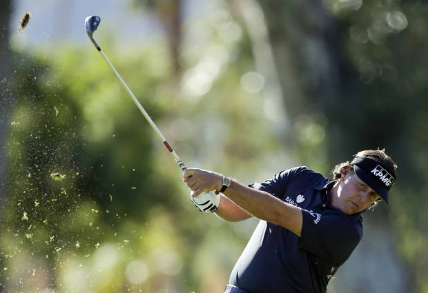 Phil Mickelson hits from a fairway on the fifth hole during the first round of the Humana Challenge golf tournament at the La Quinta Country Club in La Quinta, Calif., Thursday, Jan. 17, 2013. (AP Photo/Chris Carlson)