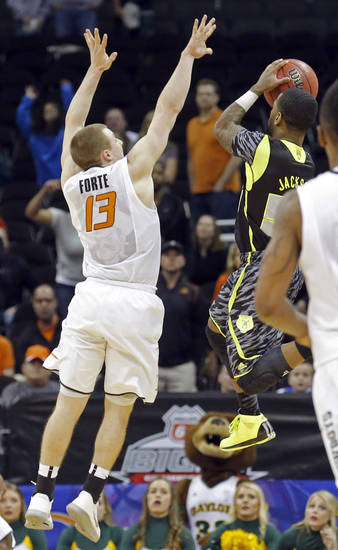 Oklahoma State's Phil Forte (13) defends against the last-second shot of Baylor's Pierre Jackson (55) during the Phillips 66 Big 12 Men's basketball championship tournament game between Oklahoma State University and Baylor at the Sprint Center in Kansas City, Thursday, March 14, 2013. Photo by Sarah Phipps, The Oklahoman