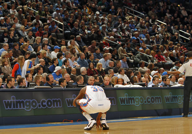 The Thunder's Kevin Durant (35) reacts after hitting his head on the court in the first half during the NBA basketball game between the Oklahoma City Thunder and the Memphis Grizzlies at the Oklahoma City Arena on Tuesday, Feb. 8, 2011, Oklahoma City, Okla.