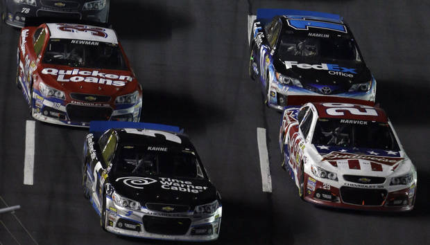 Kasey Kahne (5) and Kevin Harvick (29) race for position during a restart in the NASCAR Sprint Cup Series Coca-Cola 600 auto race at the Charlotte Motor Speedway in Concord, N.C., Sunday, May 26, 2013. Harvick went on to win the race. (AP Photo/Gerry Broome)