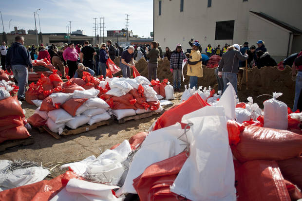 Volunteers fill sand bags Sunday, April 21, 2013 at the city's public works facility on Market street in Grand Rapids, Mich. (AP Photo/The Grand Rapids Press, Sally Finneran)