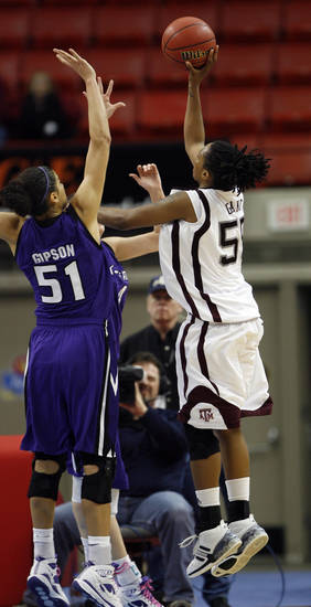 Danielle Gant (55) scores the game winning basket as Texas A&M defeats Kansas State 65-63 in the 2009 Big 12 Women's Basketball Championship game in the Cox Convention Center in Oklahoma City, Oklahoma, on Friday, March 13, 2009. 