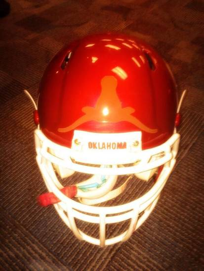 Former Oklahoma center Gabe Ikard added an upside-down Texas Longhorns sticker to his helmet for Saturday's East-West Shrine Game.