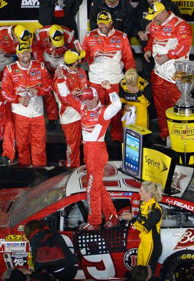 Kevin Harvick celebrates in victory lane after winning the NASCAR Daytona Sprint Unlimited auto race at Daytona International Speedway in Daytona Beach, Fla., Saturday, Feb. 16, 2013.(AP Photo/Phelan M. Ebenhack)