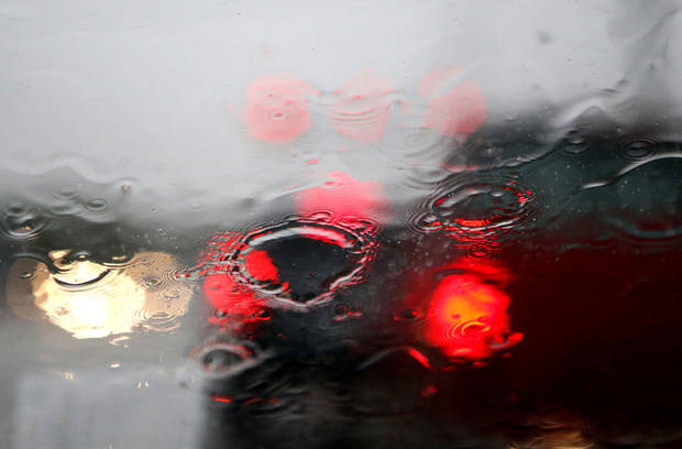Raindrops collect on a windshield during a rain shower in Oklahoma City, Saturday, Aug. 18, 2012. Photo by Sarah Phipps, The Oklahoman