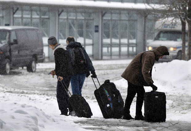 People walk in the snow at Buffalo Niagara International Airport in Buffalo, N.Y., Saturday, Dec. 29, 2012. AP photo <strong>Mel Evans</strong>