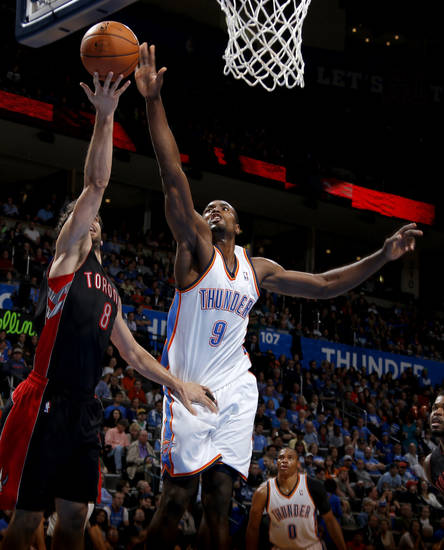 Oklahoma City's Serge Ibaka (9) blocks the shot of Toronto's Jose Calderon (8) during an NBA basketball game between the Oklahoma City Thunder and the Toronto Raptors at Chesapeake Energy Arena in Oklahoma City, Tuesday, Nov. 6, 2012.  Tuesday, Nov. 6, 2012. Oklahoma City won 108-88. Photo by Bryan Terry, The Oklahoman
