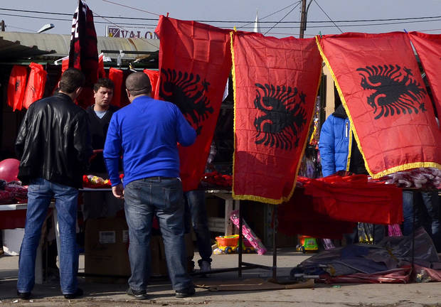 A vendor sales Albanian flags in an open market in Skopje, Macedonia, on Saturday, Nov.24, 2012. Macedonian capital Skopje, particularly the parts populated with ethnic Albanians, are flooded with Albanian flags, in the eve of the celebration of 100 years of Albania's independence and the national flag. Ethnic Albanians make up a quarter of Macedonia's 2.1 million people and are the largest ethnic minority in the country. (AP Photo/Boris Grdanoski)