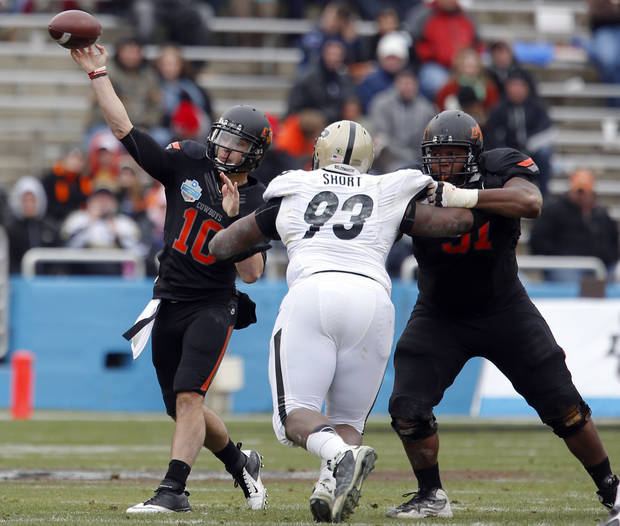 Oklahoma State's Clint Chelf (10) throws a pass during the Heart of Dallas Bowl football game between the Oklahoma State University (OSU) and Purdue University at the Cotton Bowl in Dallas,  Tuesday,Jan. 1, 2013. Photo by Sarah Phipps, The Oklahoman