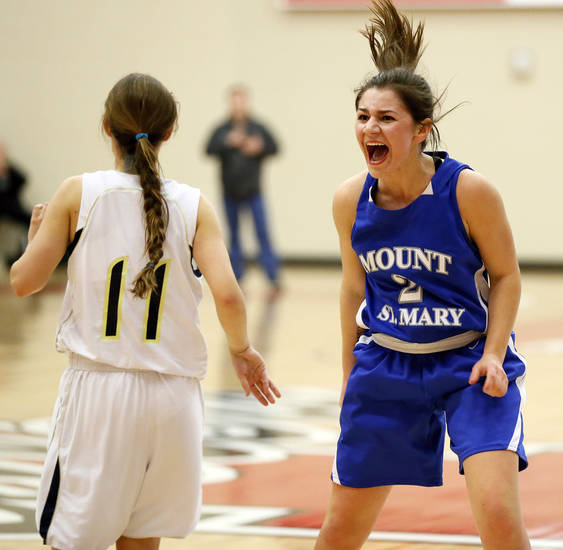 Mount St. Mary's Aimee Rishcard (2) reacts after hitting the go-ahead basket next to Heritage Hall's Baillie Miller (11) during a Class 4A girls high school playoff game between Heritage Hall and Mount St. Mary at Yukon High School in Yukon, Okla., Monday, March 4, 2013. Mount St. Mary won to advance to the state tournament. Photo by Nate Billings, The Oklahoman
