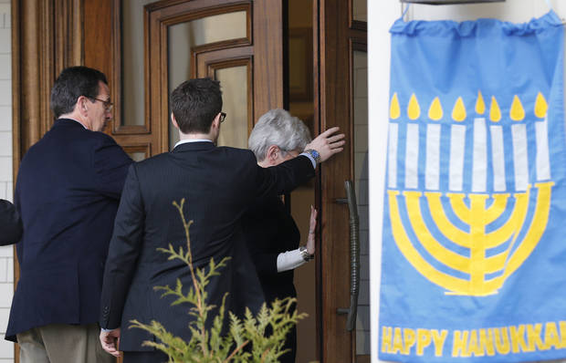 Conn. Gov. Dan Malloy, left, arrives for a service at the Congregation Adath Israel in Newtown, Conn., Saturday, Dec. 15, 2012. Rabbi Shaul Praver said a six-year-old boy from the congregation was a school shooting victim and that he would be laid to rest on Sunday. The massacre of 26 children and adults at Sandy Hook Elementary school elicited horror and soul-searching around the world even as it raised more basic questions about why the gunman, 20-year-old Adam Lanza, would have been driven to such a crime and how he chose his victims. (AP Photo/Charles Krupa) ORG XMIT: CTCK105