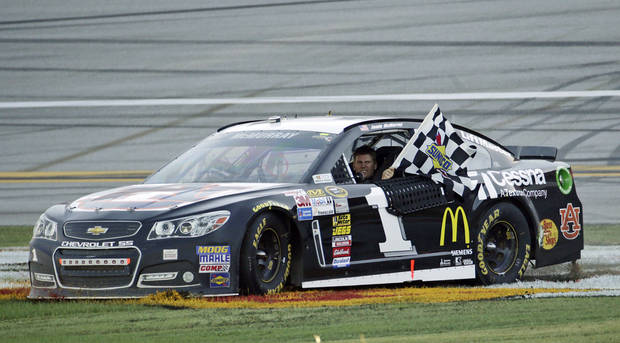 Sprint Cup Series driver Jamie McMurray (1) celebrates after wining the NASCAR Sprint Cup Series auto race at the Talladega Superspeedway in Talladega, Ala., Sunday, Oct. 20, 2013. (AP Photo/Dave Martin)
