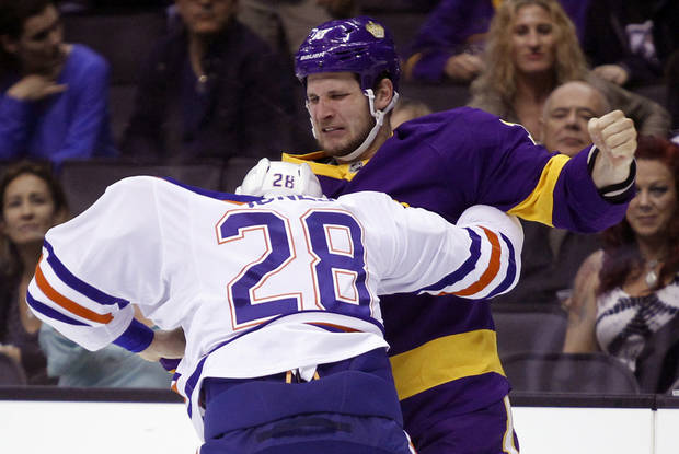 Los Angeles Kings left wing Kyle Clifford, right, scuffles with Edmonton Oilers left wing Ryan Jones (28) during the second period of an NHL hockey game Sunday, Oct. 27, 2013, in Los Angeles.  (AP Photo/Alex Gallardo)