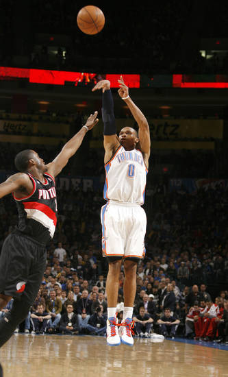 Oklahoma City's Russell Westbrook (0) shoot over Portland's Wesley Matthews (2) during the NBA game between the Oklahoma City Thunder and the Portland Trailblazers, Sunday, March 27, 2011, at the Oklahoma City Arena. Photo by Sarah Phipps, The Oklahoman