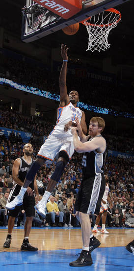 Oklahoma City Thunder's Kevin Durant (35) shoots a lay up over San Antonio Spurs' Matt Bonner (15) during the the NBA basketball game between the Oklahoma City Thunder and the San Antonio Spurs at the Chesapeake Energy Arena in Oklahoma City, Sunday, Jan. 8, 2012. Photo by Sarah Phipps, The Oklahoman