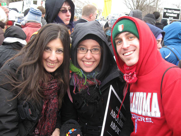 Sheila Mazkoori, of Norman, left, Emily Corrall, of Tulsa, and Garrett Finnell, of Edmond, joined the annual anti-abortion march to the U.S. Supreme Court on Friday. Photo by Chris Casteel, The Oklahoman