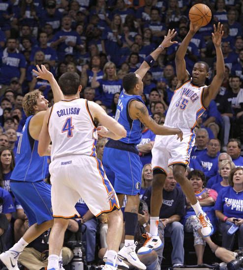 Oklahoma City's Kevin Durant (35) passes the ball over Shawn Marion (0) of Dallas during game 3 of the Western Conference Finals of the NBA basketball playoffs between the Dallas Mavericks and the Oklahoma City Thunder at the OKC Arena in downtown Oklahoma City, Saturday, May 21, 2011. Photo by Chris Landsberger, The Oklahoman