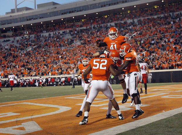 OSU / CELEBRATION: Oklahoma State celebrates a touchdown on a blocked punt during a college football game between Oklahoma State University and the Texas Tech University (TTU) at Boone Pickens Stadium in Stillwater, Okla., Saturday, Nov. 17, 2012. Photo by Sarah Phipps, The Oklahoman