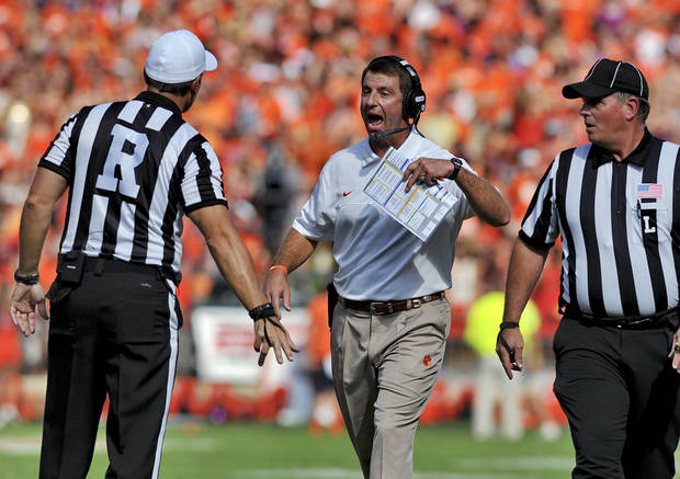 Clemson coach Dabo Swinney disputes a call with the referee during the second quarter of an NCAA college football game against Georgia Tech on Saturday, Oct. 6, 2012, at Memorial Stadium in Clemson, S.C.(AP Photo/ Richard Shiro)