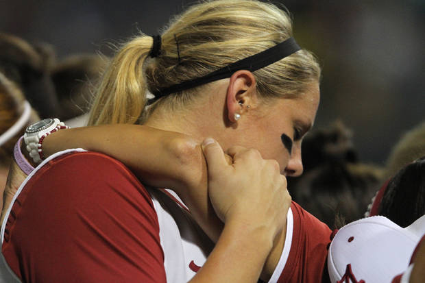 Alabama's Amanda Locke (22) prays with her team before Game 3 of the Women's College World Series softball championship between OU and Alabama at ASA Hall of Fame Stadium in Oklahoma City, Wednesday, June 6, 2012.  Photo by Garett Fisbeck, The Oklahoman
