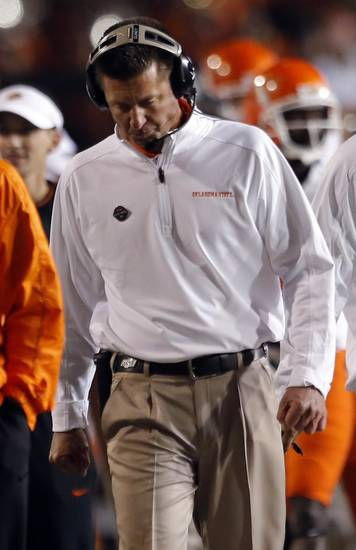 Oklahoma State head coach Mike Gundy walks the sidelines during the college football game between Kansas State University (KSU) and Oklahoma State (OSU) at  Bill Snyder Family Football Stadium in Manhattan, Kan.,  Saturday, Nov. 3, 2012. Photo by Sarah Phipps, The Oklahoman