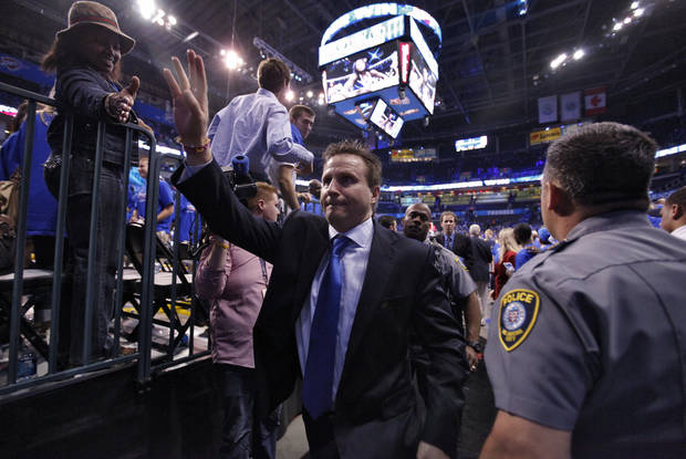 Thunder coach Scott Brooks waves to fans as he makes his way off the court after the 107-103 win over Denver during the first round NBA playoff game between the Oklahoma City Thunder and the Denver Nuggets on Sunday, April 17, 2011, in Oklahoma City, Okla. Photo by Chris Landsberger, The Oklahoman